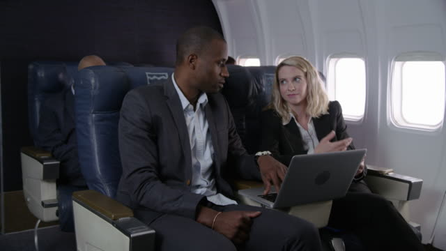 People working on airplane flight video