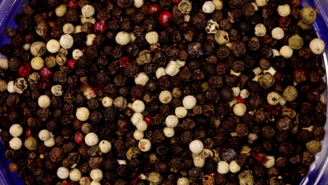 Peppercorns mix. Kitchen herbs background video