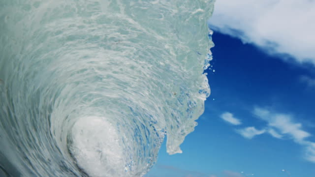 A perfect beautiful wave POV as wave breaks over camera on shallow sand beach in the California summer sun. Shot in slowmo on the Red Dragon at 300FPS. video