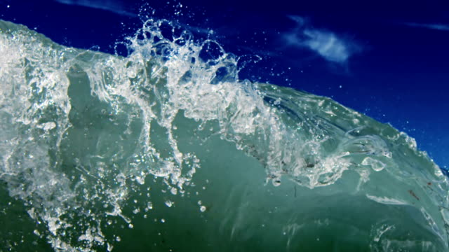 A perfect detailed beautiful wave POV as wave breaks over camera on shallow sand beach in the California summer sun. Shot in slowmo on the Red Dragon at 300FPS. video