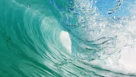 Perfectly detailed beautiful wave POV as wave breaks over camera on shallow sand beach in the California summer sun. Shot in slowmo on the Red Dragon at 300FPS. video