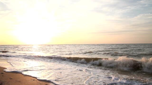 Person contains runs along the shore video