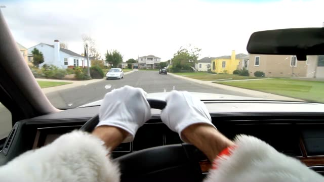 POV of person driving. Road rage point of view. Person wearing santa claus costume and driving video