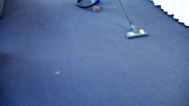 Person Hoovering Carpet video