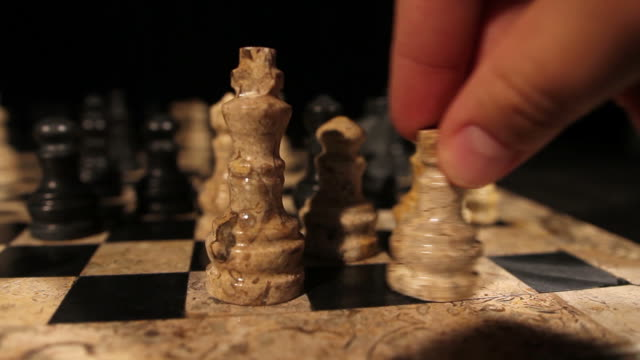 A person makes a castling in a chess game video