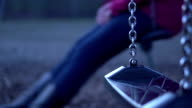 Person on swing in park at night video