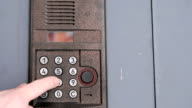 Person opening door using a numeric code of access video