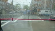 Person point of view umbrella heavy rain walking on street video
