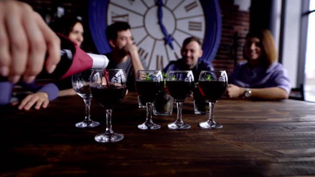 Person pouring wine in glasses video