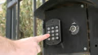 Person push buttons on a panel of intercom system video