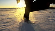 SLO MO Person Running In Snow At Sunset video