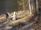 Person With Dog at Riverbank video