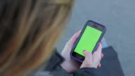 Person Young lonely woman surfing on smart phone green screen video