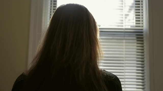 Person Young sad wondering woman Window Rear view People video