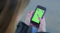 Person Young woman texting smart phone tracking marks green screen video