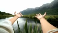 Personal perspective of a woman arms outstretched embracing nature video