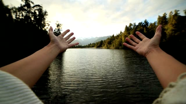 Personal perspective of person embracing nature video