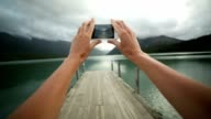 Personal perspective of person taking picture using mobile phone video