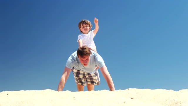 Personal trainer  - father and son do press ups on the beach video