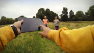 Personal trainer POV: following schedule on tablet video