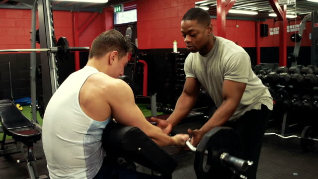 Personal trainer in the gym weight training video