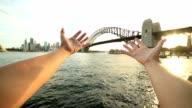 Person's arms stretch towards Sydney skyline, Australia video