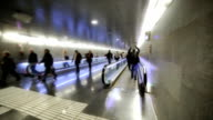 Persons moving in underground corridor. Slow motion video