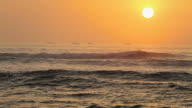 Peruvian sunset with boats on the horizon video