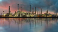 Petrochemical industry - Oil refinery with reflection, Time lapse video