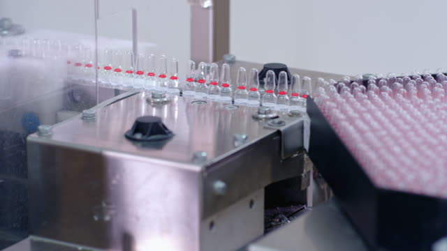 Pharmaceutical manufacturing line. Medical ampoules on production line video