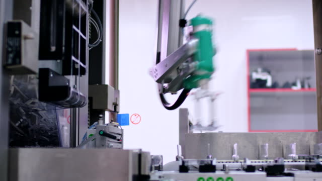 Pharmaceutical production line. Robotic arm of packaging machine video
