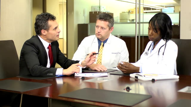 Pharmaceutical Representative Meets with Doctors - WS video