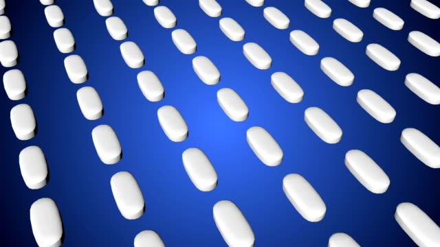Pharmaceutical tablets moving background video