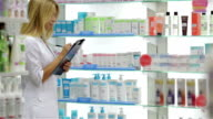 Pharmacist accounting the product in drugstore video