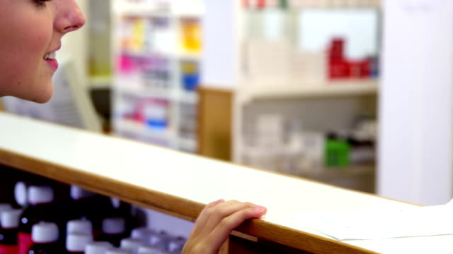 Pharmacist assisting the medicine to customer video
