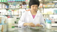 HD : Pharmacist is working at drugstore video