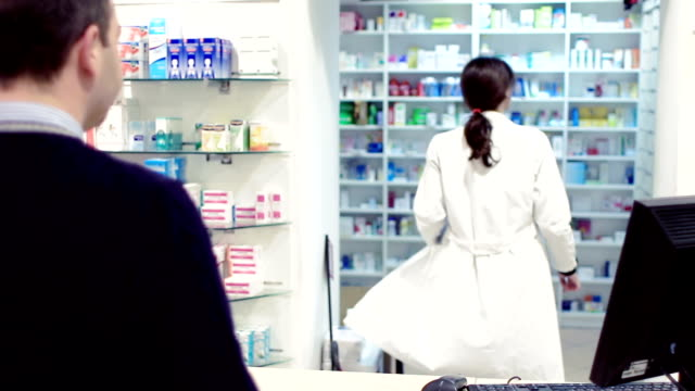 Pharmacist taking medicines for customer video