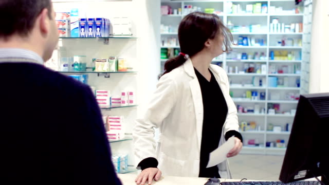 Pharmacist taking medicines for customer video
