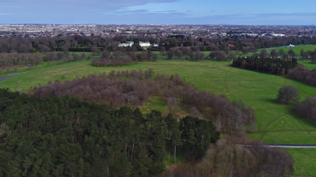 Phoenix park with presiden't residence and city in view Dublin Ireland video