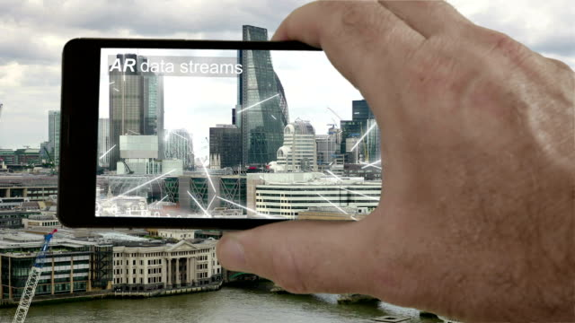 AR phone app showing streams of binary data flying round London. video
