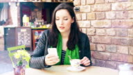 Phone message. Sidewalk cafe, coffee. video