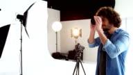 Photographer checking camera lens video