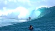 SLOW MOTION: Photographer filming surfer surfing big tube barrel wave video