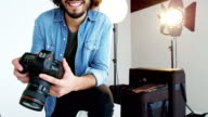 Photographer holding digital camera video