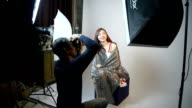 Photographer shooting fashion model in the studio. video