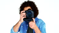 Photographer showing visiting card while taking photo with digital camera video