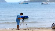 Photographer taking photo at beach video