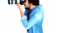 Photographer taking photo with professional digital camera video