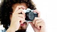 Photographer taking photo with vintage camera video