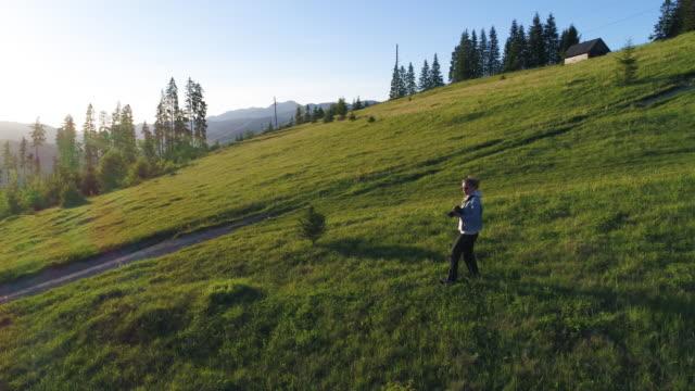 Photographer woman walking, sunset time video